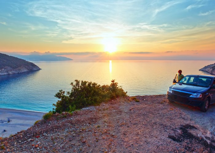 car overlooking greek sunset