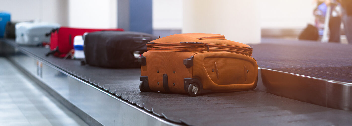 suitcases on luggage carousel.