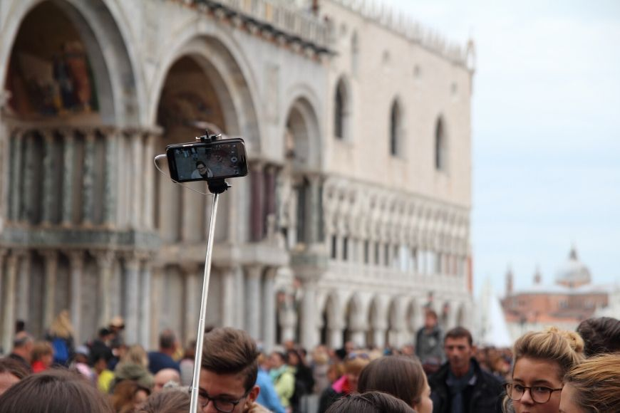 selfie stick in crowd in venice.