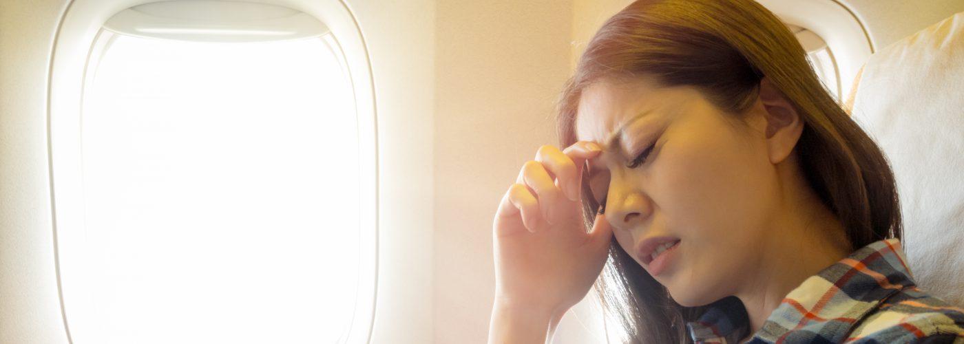 unhappy woman on plane