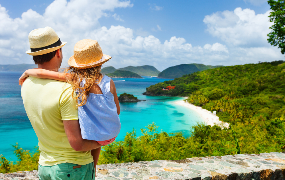 Man carrying child looking at beach in usvi