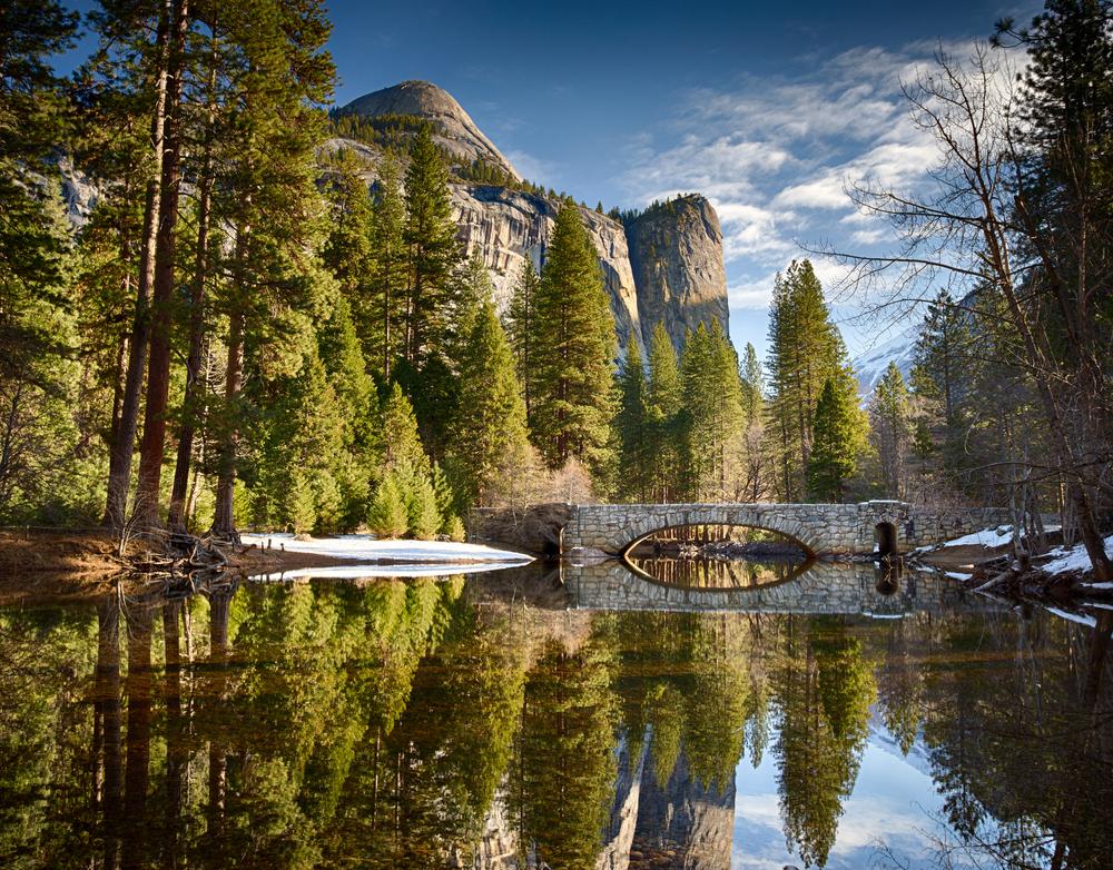 reflection of bridge and nature at yosemite national park