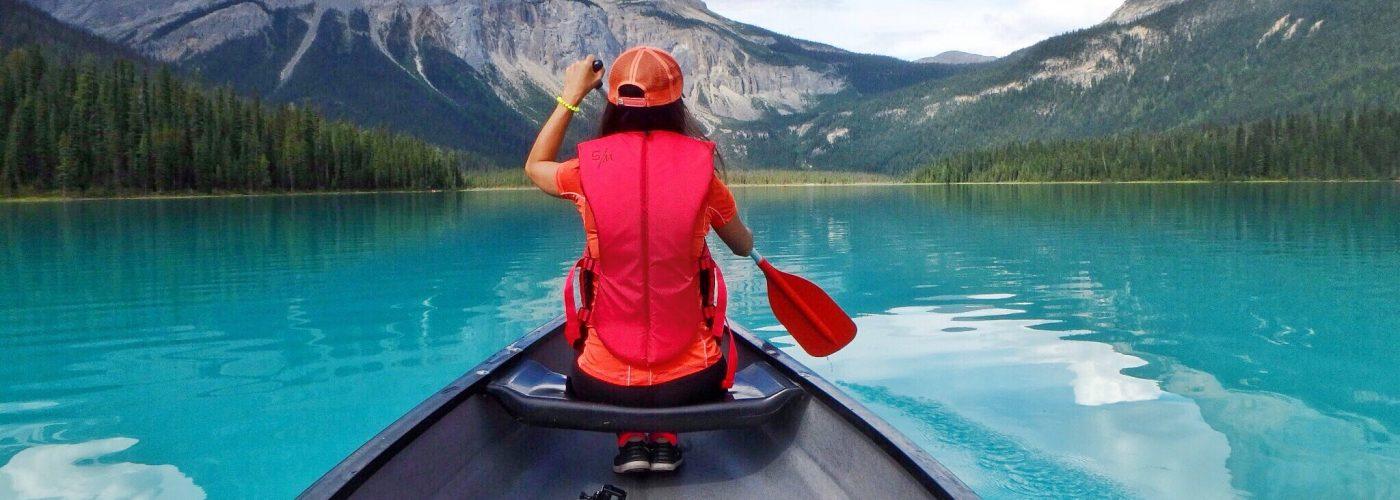 woman canoeing emerald lake canada