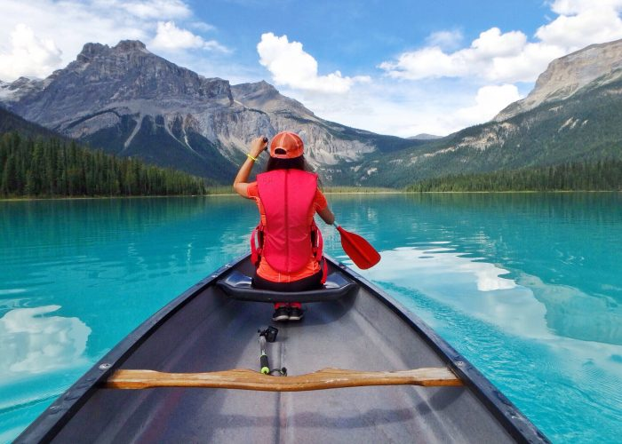 woman canoeing emerald lake canada