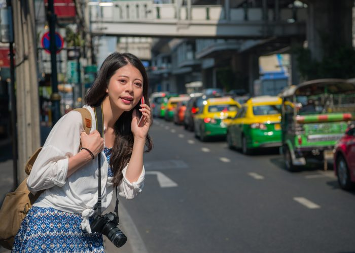 Female tourist waiting for taxi or rideshare