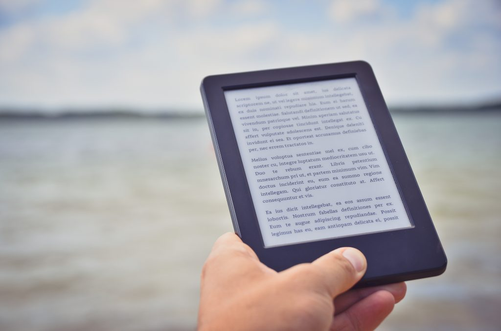 kindle e reader with ocean background