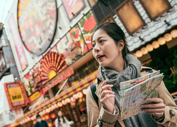 tourist holding map sightseeing city