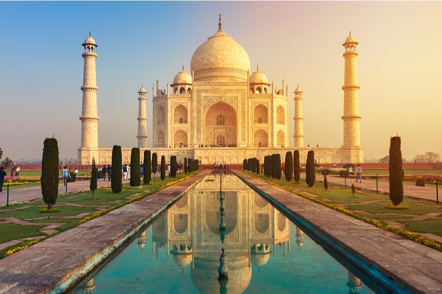 Taj Mahal reflection at sunrise India.