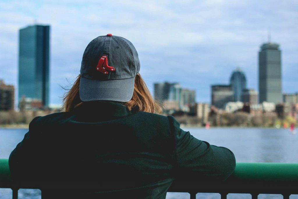 woman wearing red sox cap boston