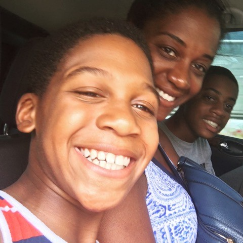 mom and sons in back seat