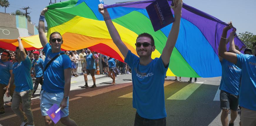 men flying gay flag west hollywood california parade