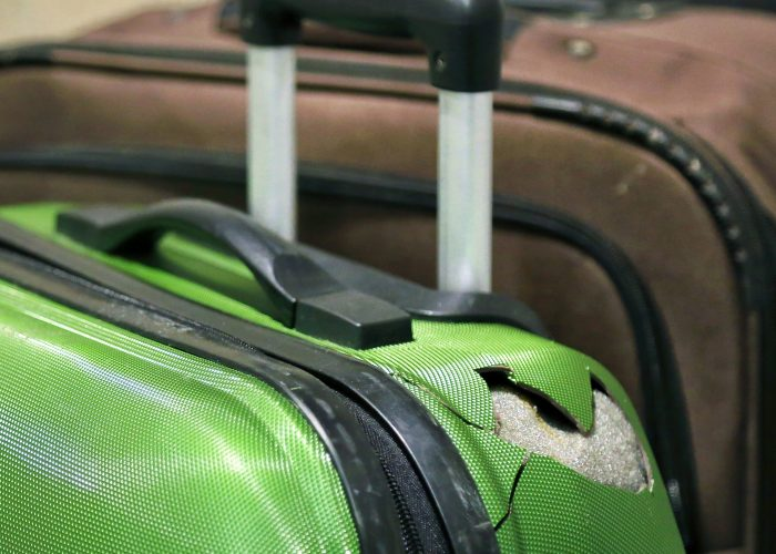 Mystery Solved: Here's Why Your Checked Luggage Gets so Beat-Up