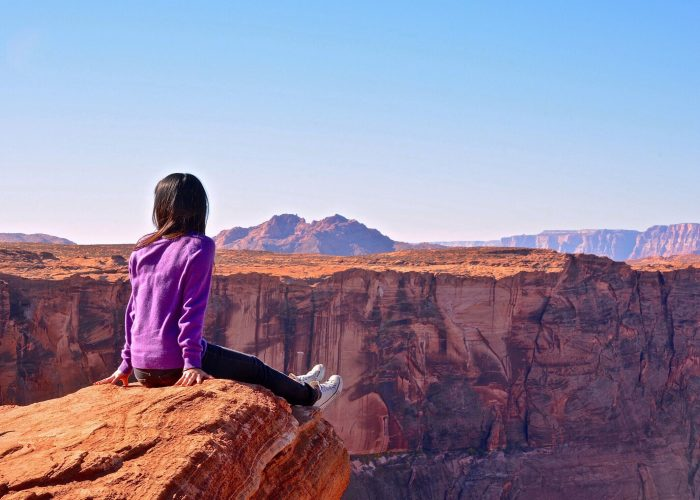 Woman-Sitting-Looking-Canyon