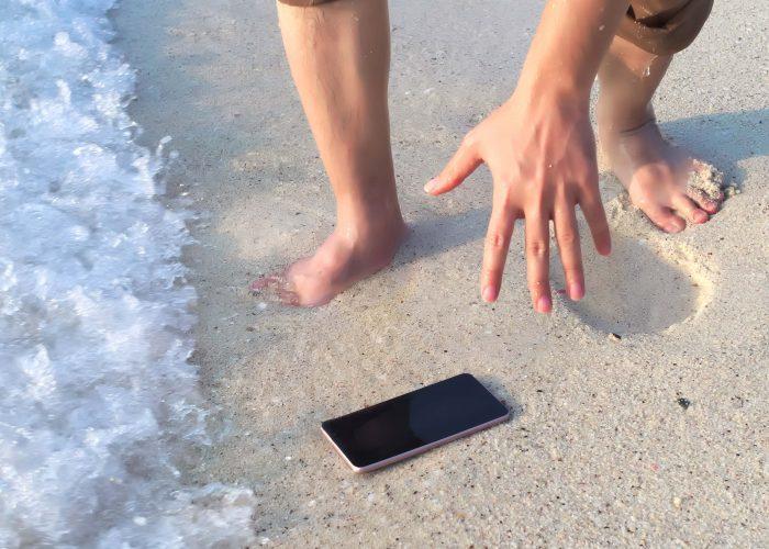Beach Reaching for Phone