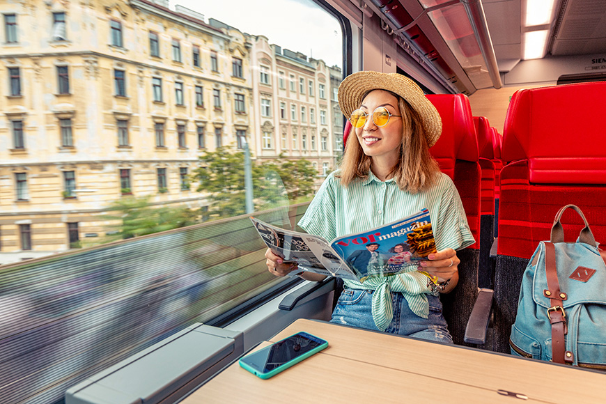 traveling passenger girl reading magazine in QBB train in Vienna