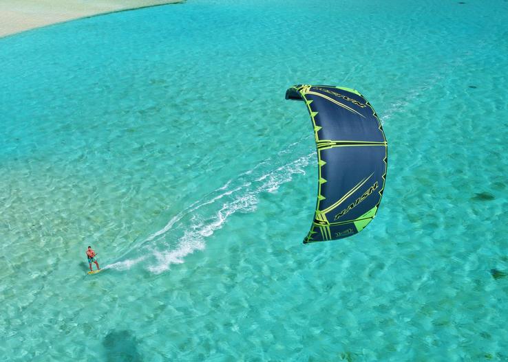 Kitesurfer in blue water