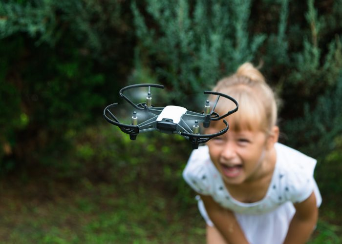 small drone and girl