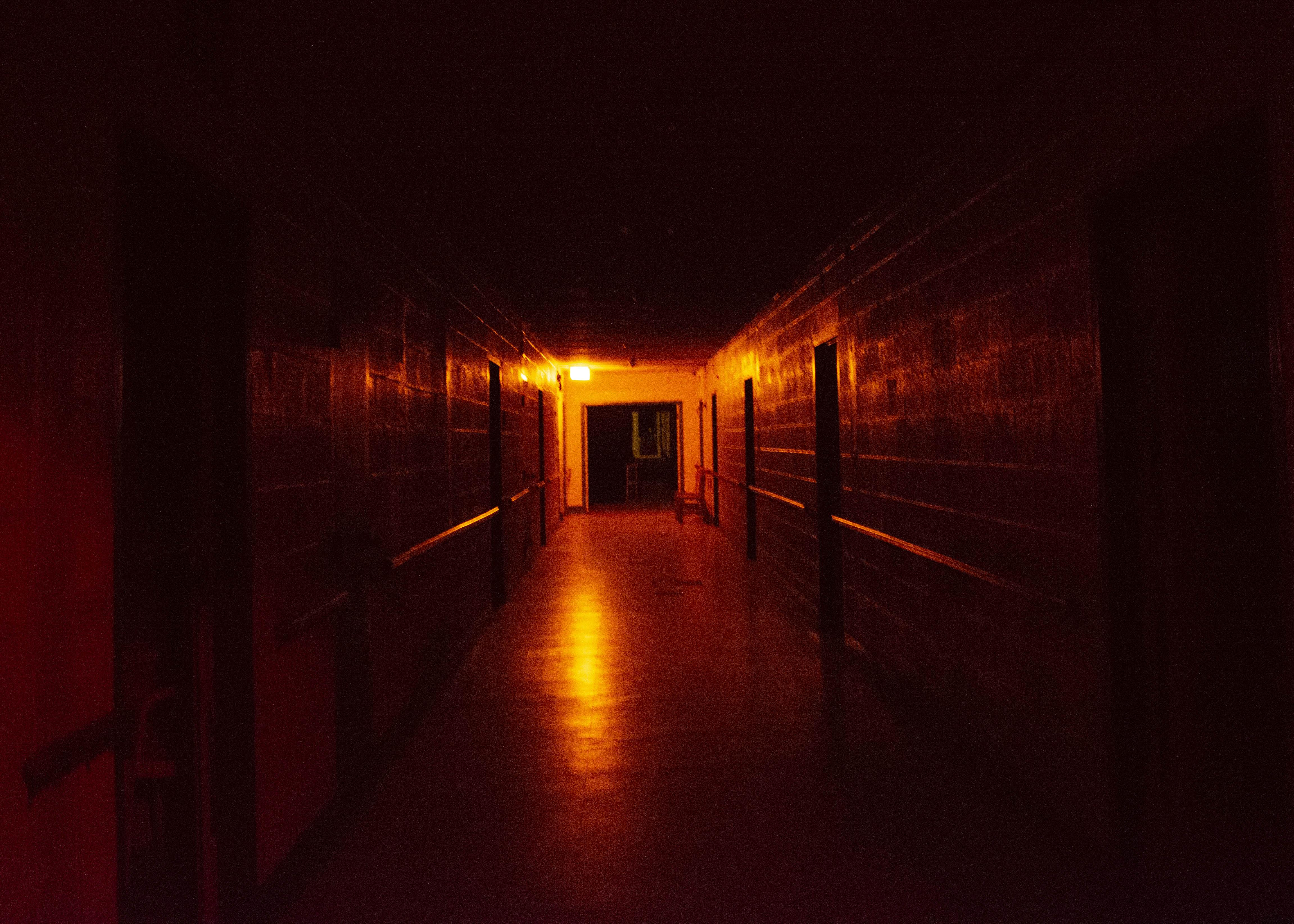spooky hallway inside rolling hills asylum