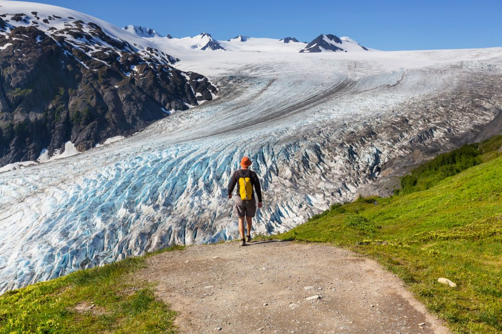 Kenai fjords national park - male walking along glacier