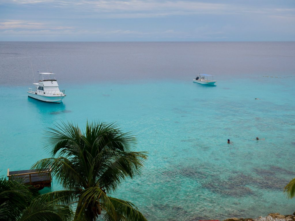 boats in blue water view of ocean curacao