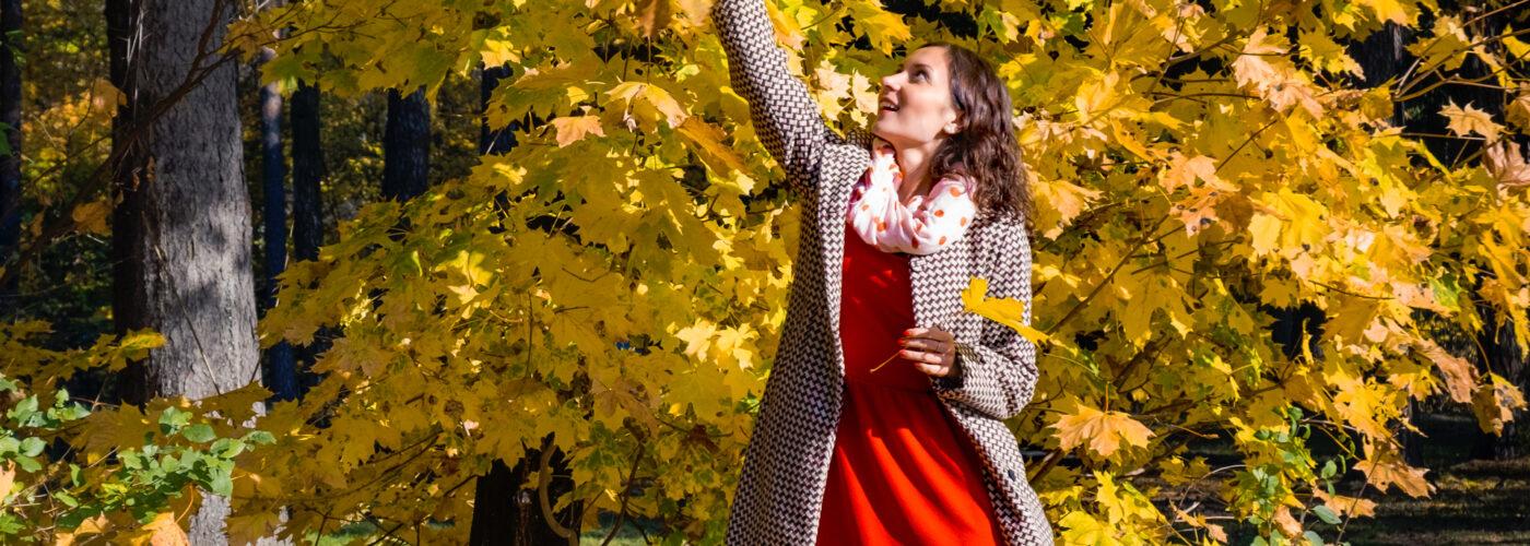 Women in Fall Dress Picking Fall Foliage