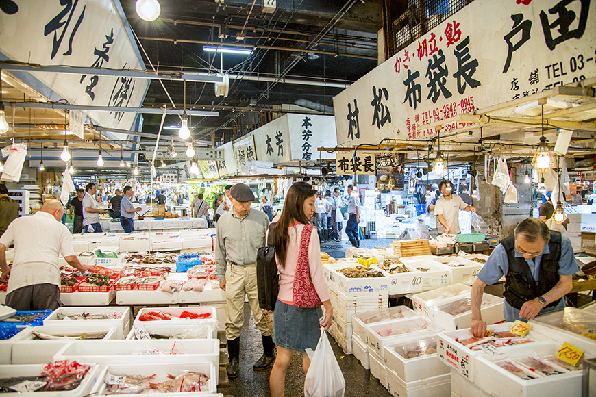 Merchants sale seafood in Tsukiji fish market on July 27, 2013 in Tsukiji, Japan. Tsukiji fish market is one of biggest fish market in the world