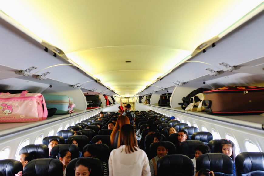 line of people standing on plane