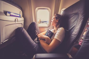 The One Thing You Need to Do on a Red-Eye Flight hero