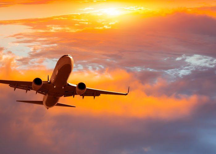 airplane-in-sky-sunrise