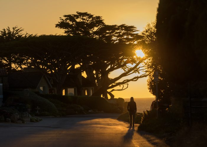 person walking at sunset in Carmel-by-the-Sea