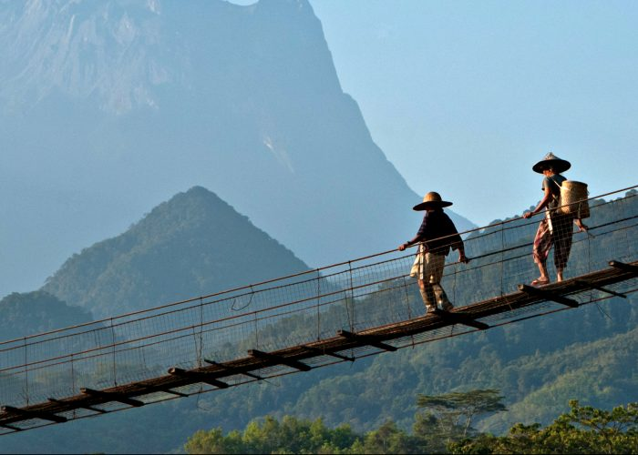 two people on suspension bridge