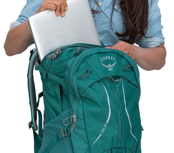 Woman packing the Osprey Talia Backpack