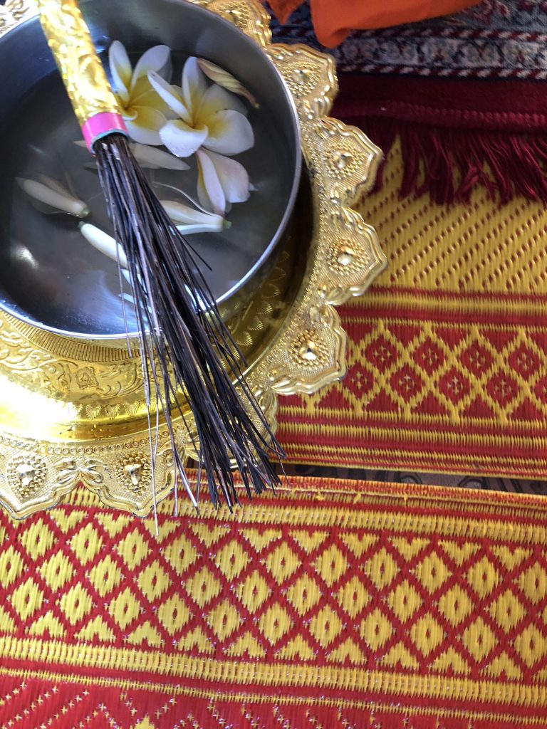 overhead image of a water blessing bowl in small temple cambodia