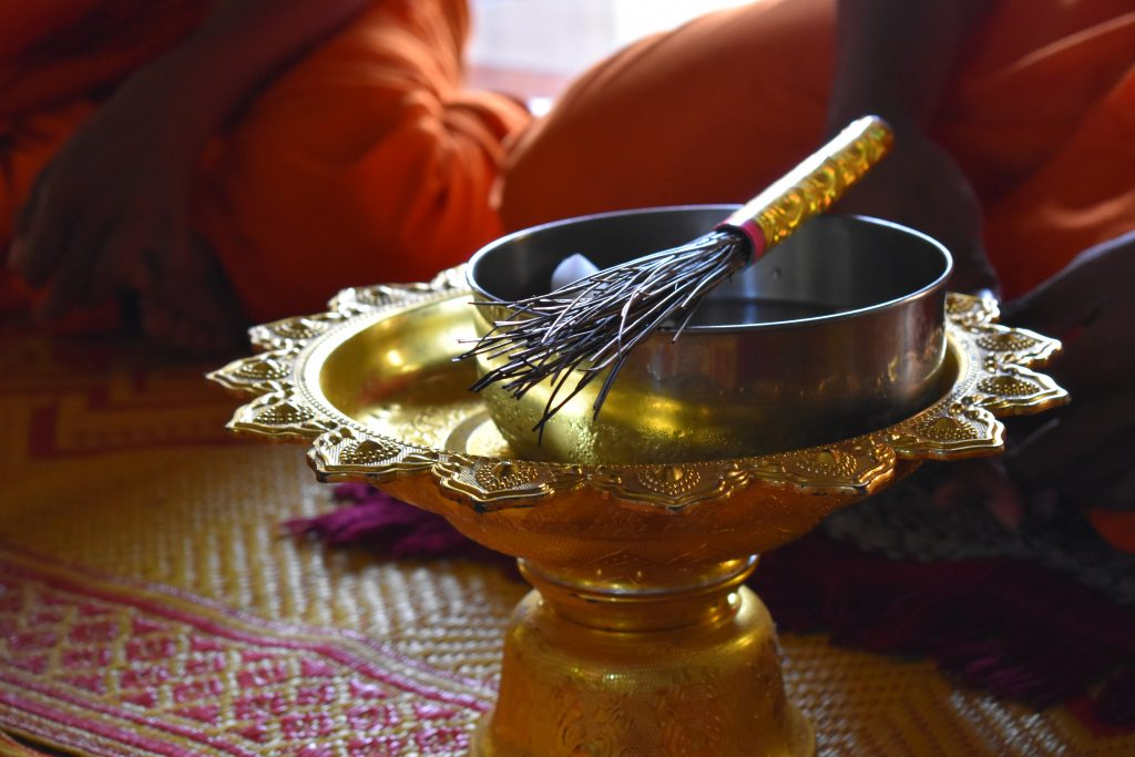 side image of a water blessing bowl in small temple cambodia