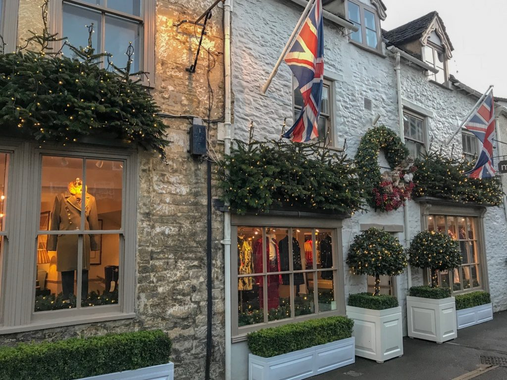 old english stone store front decorated for christmas