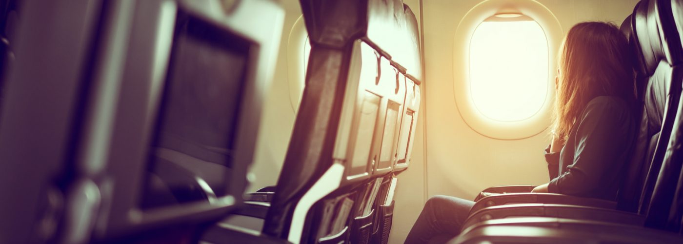 person sitting in airplane seat