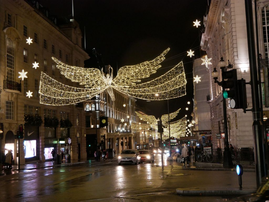 busy street in london with holiday lights