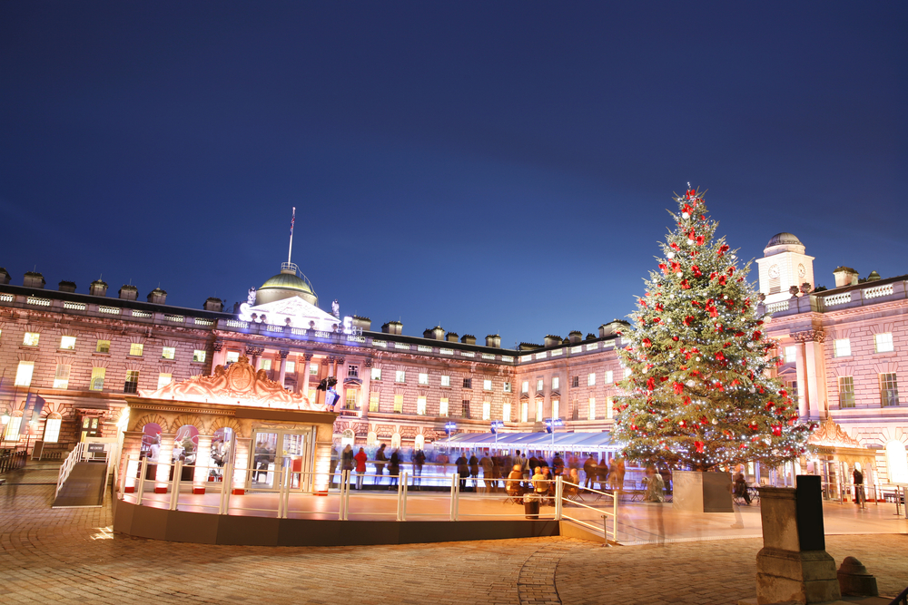 ice skating rink with christmas tree outdoors in london