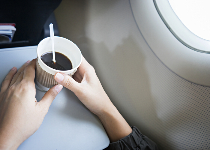 coffee on airplane tray table