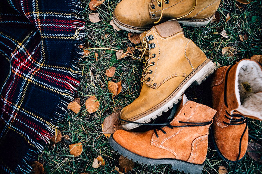 pile of shoes on grass