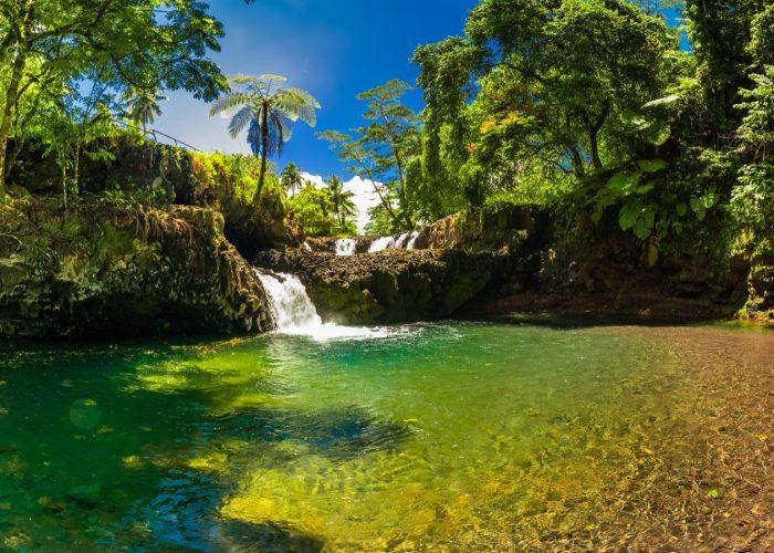 Vibrant Togitogiga falls with swimming hole on Upolu, Samoa Islands