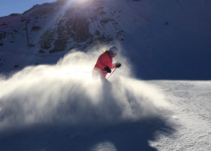 skier creating snow cloud