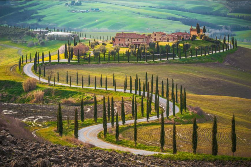 tuscany italy winding road.
