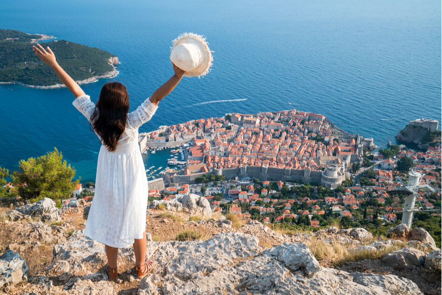 woman standing above dubrovnik.