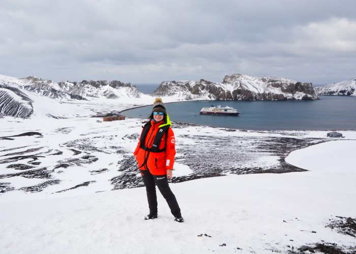 Woman Standing on Deception Island in Antarctica