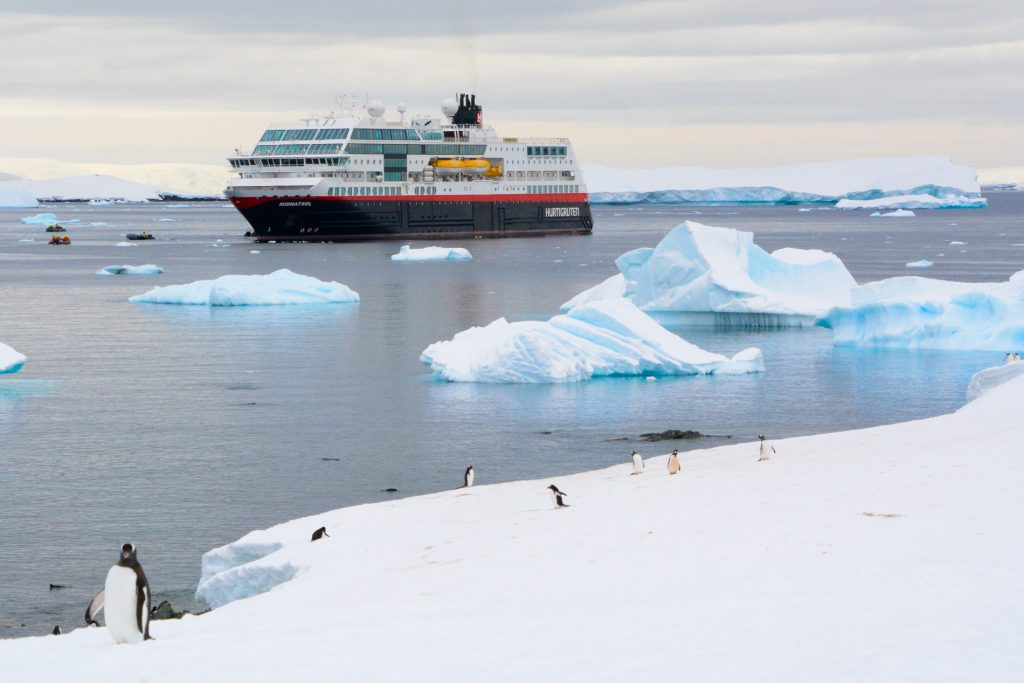 Cruise ship in antarctica with penguins