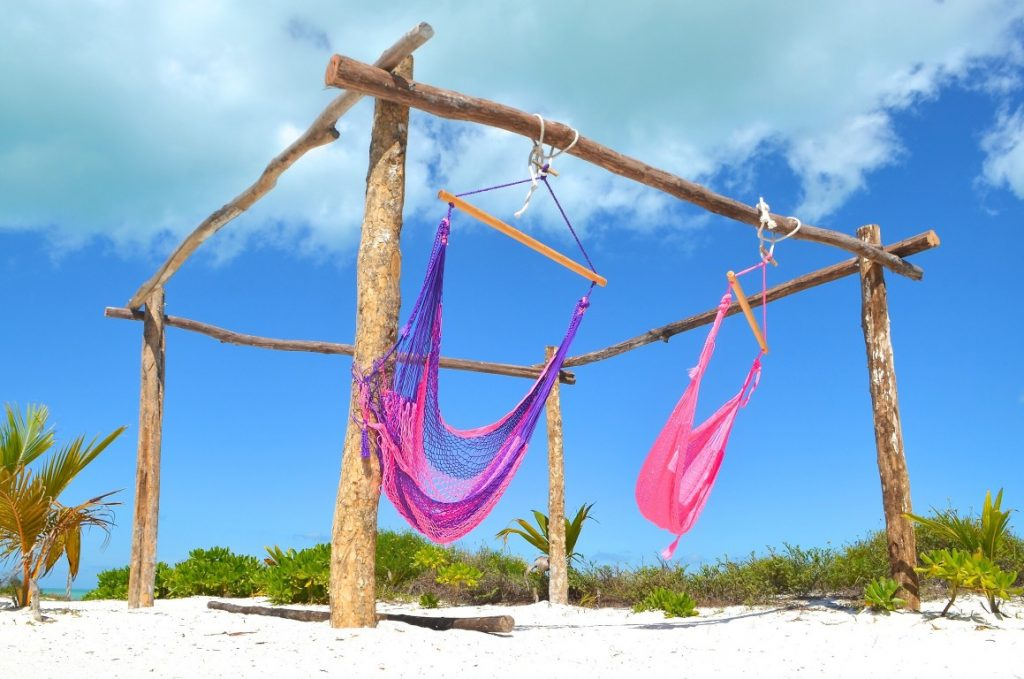 Hammocks on beach in holbox island
