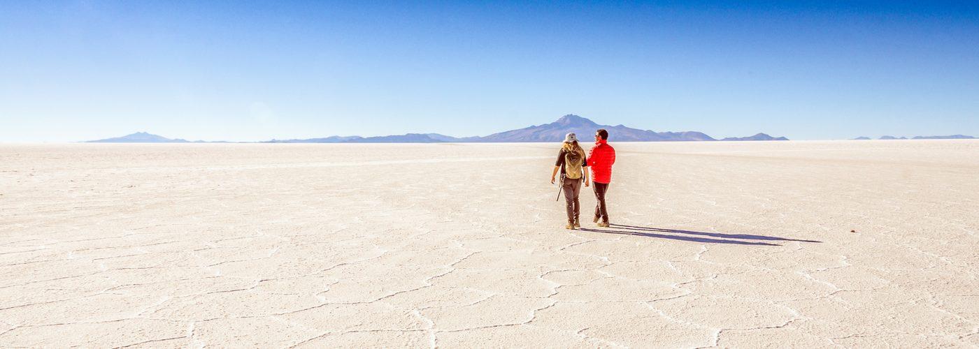 couple-walking-salt-flats-bolivia