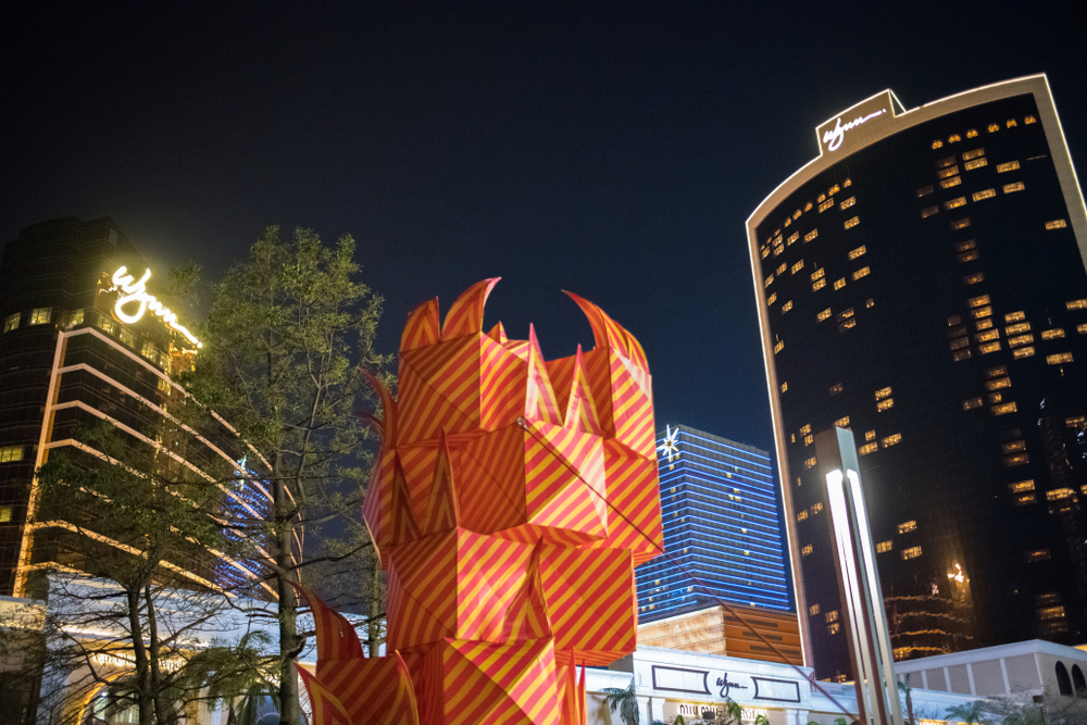 sculptures and buildings at night in macau
