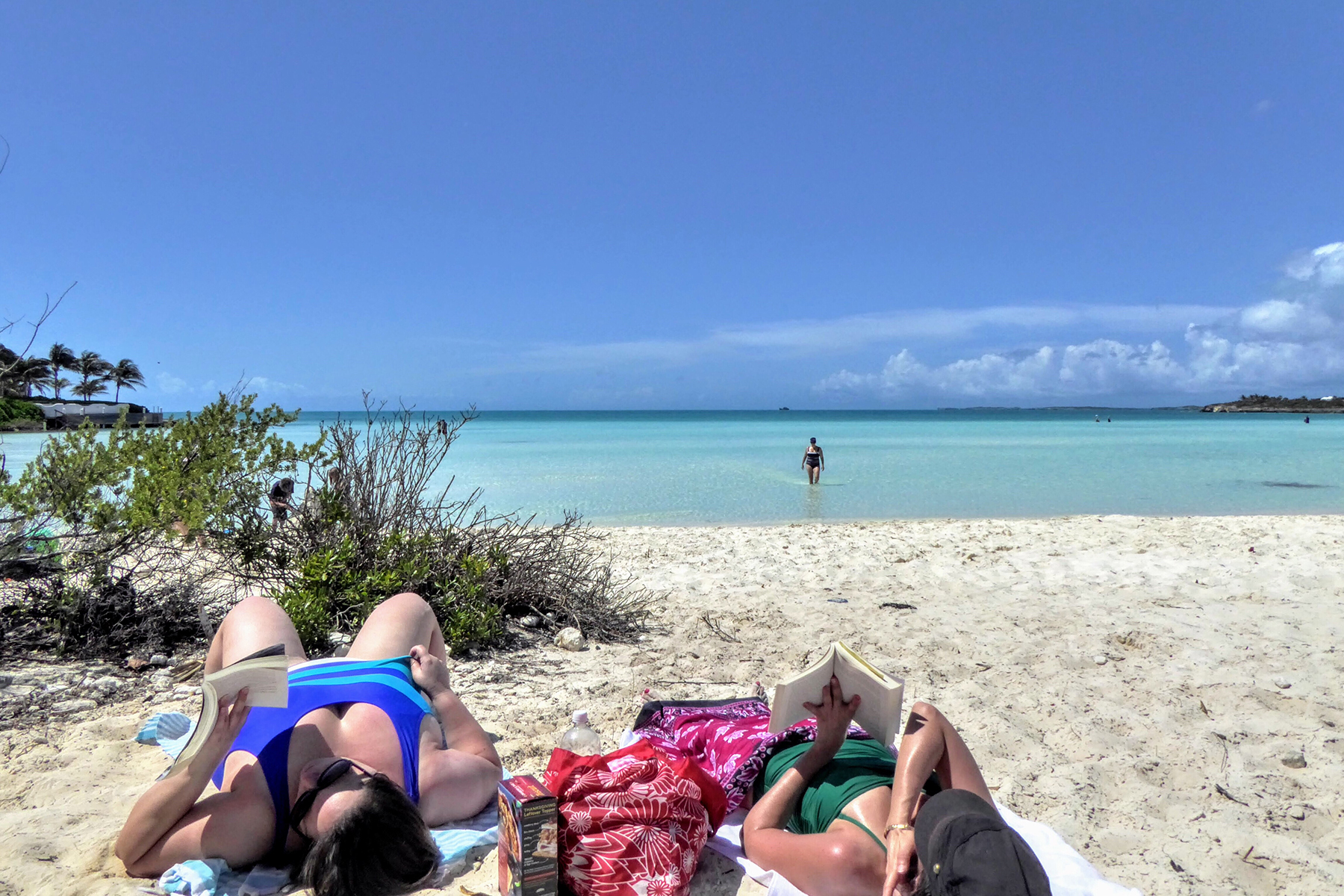 people lying on beach in turks and caicos
